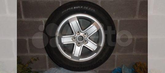 Продам комплект летних оригинальных колес от KIA